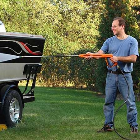 Man Washing Car With Generac 7019 Washer