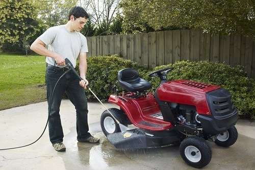 Man Washing Lawn Tractor