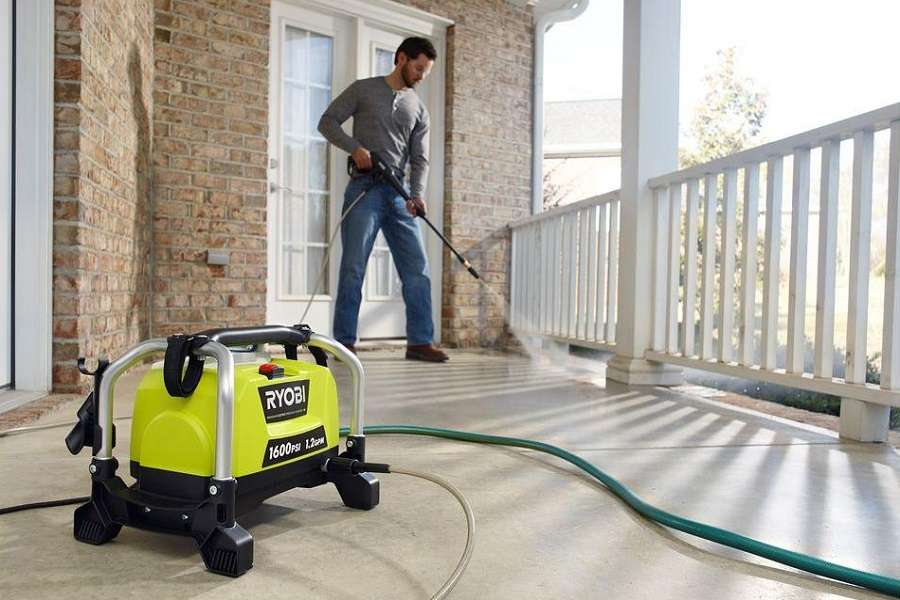Man Washing Terrace With Ryobi ZRRY141600