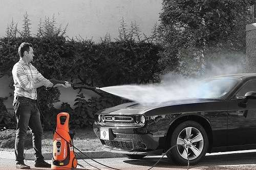cleaning a car with an electric pressure washer
