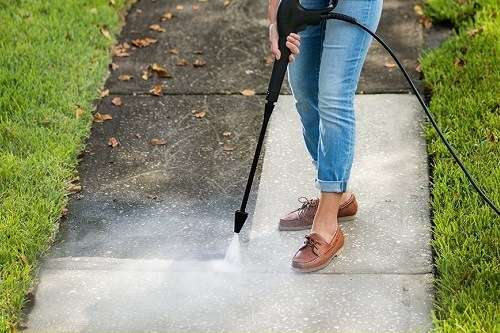 cleaning pavement with an electric pressure washer